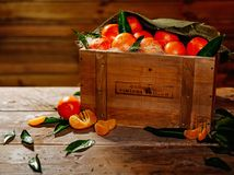 Wooden crate with tasty tangerines Royalty Free Stock Image