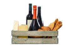 Wooden crate with vine, cheese and pastry on white background stock images