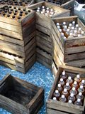 Wooden crates of apple juice bottle Royalty Free Stock Photography