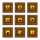 Wooden crates with danger signs Stock Images