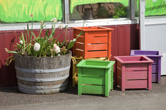 Wooden crates and old half barrell. Wooden crates and old half barrell with plants royalty free stock photos