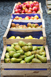 Wooden crates with pears and apples Stock Images