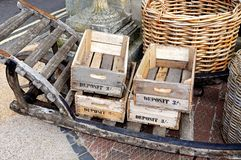 Wooden crates and wicker baskets. Stock Images