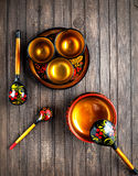 Wooden crockery painted with Khokhloma Royalty Free Stock Image
