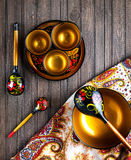 Wooden crockery painted with Khokhloma Royalty Free Stock Images