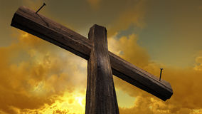Wooden cross. Against the sky with shining rays Stock Photos