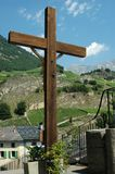 Wooden Cross. Reverse side of Wooden Cross with a background of  mountains and vineyards in Swiss Alps Stock Photography