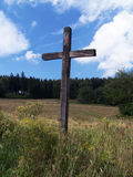 Wooden cross. Old wooden cross near the path Stock Photography