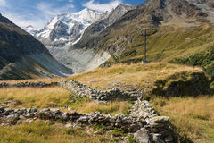 Wooden cross above valley in Val D'Anniviers Royalty Free Stock Photography