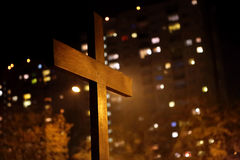 Wooden cross against block of flats.  royalty free stock images