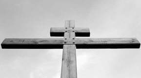 Wooden cross against the sky. Stock Photo
