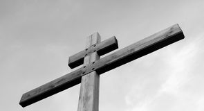 Wooden cross against the sky. Royalty Free Stock Images