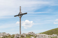 Wooden cross in the alps in Austria Stock Photo