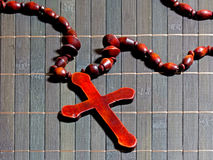 Wooden cross on a bamboo mat Royalty Free Stock Photo