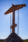 Wooden cross and a beautiful blue sky. Looking up at a wooden cross and a beautiful blue sky Royalty Free Stock Photography