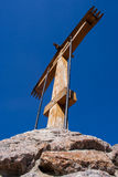 Wooden cross and a beautiful blue sky Royalty Free Stock Photo