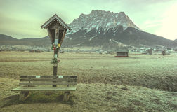 Wooden cross and bench Royalty Free Stock Photography