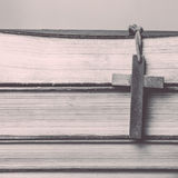 Wooden cross with books Royalty Free Stock Photography