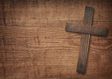 Wooden cross on brown old table top Stock Photos
