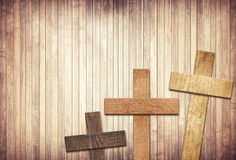 Wooden cross on brown old tabletop or wall surface Royalty Free Stock Images