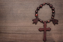 Wooden cross on brown table background Stock Photography