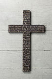 Wooden cross with carved the Lord`s Prayer on white worn wooden background Stock Images