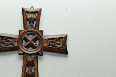 Wood Cross Left. A wooden cross, Celtic style, on the left side of the frame with light shining from overhead stock images