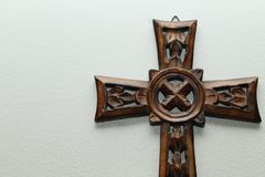 Wood Cross Right. A wooden cross, Celtic style, on the right side of the frame with light shining from overhead stock photography