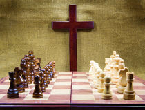 Wooden Cross and Chessboard Royalty Free Stock Images