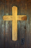 Wooden cross on a church door Royalty Free Stock Photo
