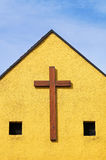 Wooden cross on the church wall Royalty Free Stock Image