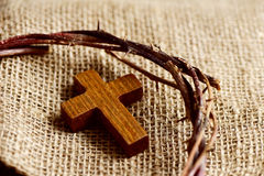 Wooden cross and the crown of thorns of Jesus Christ Royalty Free Stock Photo