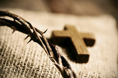 Wooden cross and the crown of thorns of Jesus Christ Royalty Free Stock Images