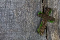 Wooden cross or crucifix on a background for a condolence card. Stock Image