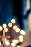 Wooden Cross and Defocused Lights Royalty Free Stock Images