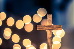Wooden Cross and Defocused Lights Stock Photography
