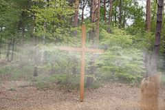 Wooden cross in the forest Stock Image