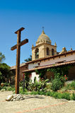 Wooden cross in front of Mission belltower Stock Images