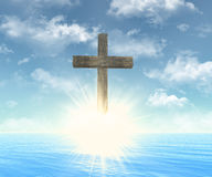 Wooden cross in front of sun Stock Image