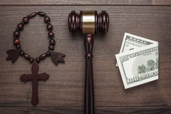 Wooden cross gavel and money on brown table Royalty Free Stock Photos