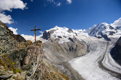 The wooden cross and glacier at Gornergrat station in summer, Z royalty free stock photography