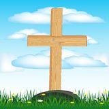 Wooden cross on grave Stock Images