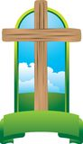 Wooden cross in green display Royalty Free Stock Image
