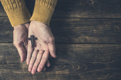 Wooden cross on  hands Royalty Free Stock Image