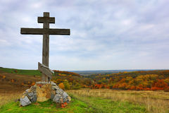 Wooden cross on hill. In autumn time Stock Photos