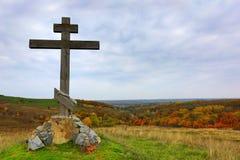Wooden cross on hill Stock Photos