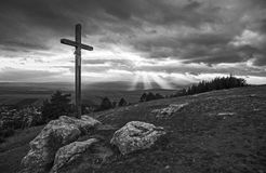 Wooden cross on hill in black and white Royalty Free Stock Image