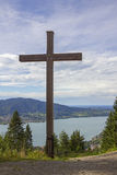 Wooden cross at hillside walkway Stock Photos