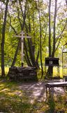 Wooden cross and icons of the memory of Grigory Rasputin and unfinished temple in the Alexander Park. ST. Petersburg, Russia - August 19, 2017: Memorial Cross of Royalty Free Stock Photos