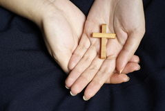 Wooden Cross In Female Hands Stock Images